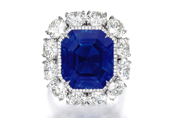 Centring on a step-cut sapphire weighing 17.16 carats, surrounded by circular-cut and brilliant-cut diamonds together weighing approximately 6.00 carats, mounted in platinum. Ring size: 5¾